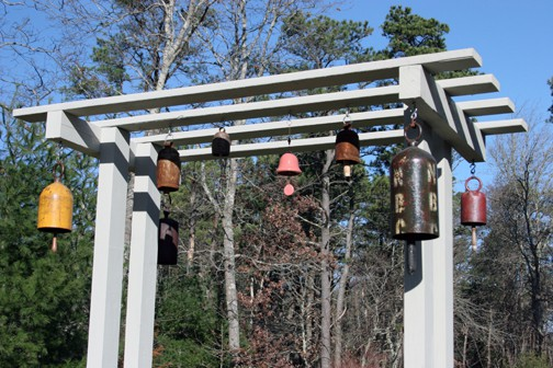 The bell on the left, and the two on the right, were made by Provincetown artist Michael Kacergis.